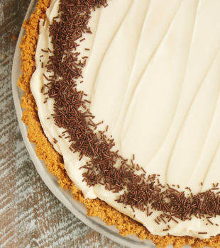 No-Bake Irish Cream Cheesecake garnished with chocolate sprinkles