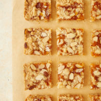 Apricot Almond Oat Bars on parchment paper