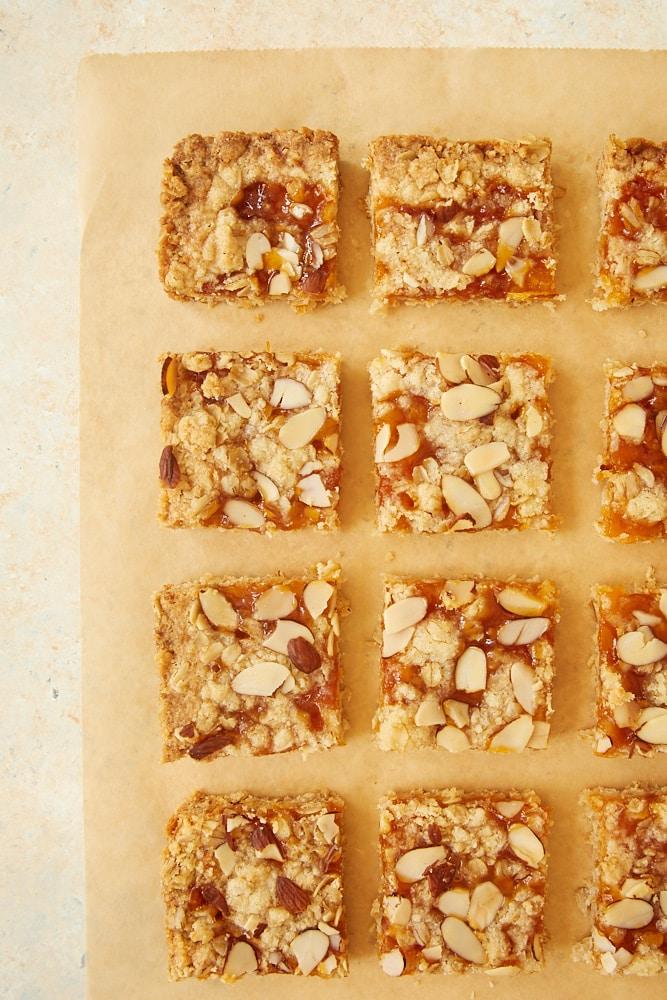 Apricot Almond Oat Bars on parchment paper